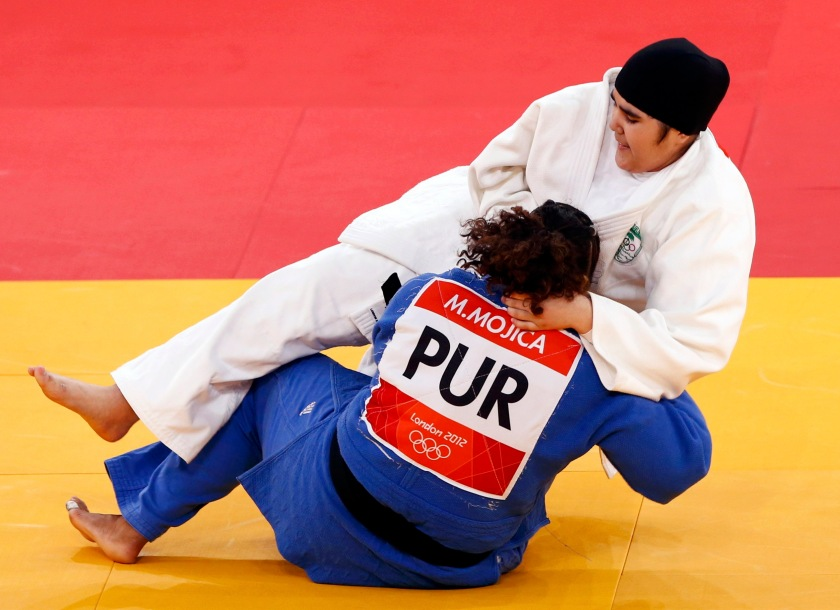 Saudi Arabia's Wojdan Shaherkani fights with Puerto Rico's Melissa Mojica during their women's +78kg elimination round of 32 judo matchat the London 2012 Olympic Games