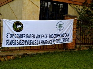 Signs throughout Kigali, Rwanda promote gender equality and non-violence.