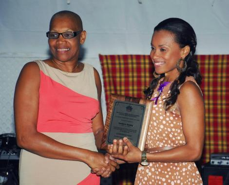 Hon. Marcella Liburd, Minster of Gender Affairs, presents the 2013 International Women's Day Award for Entrepreneurship to Genieve Hanley