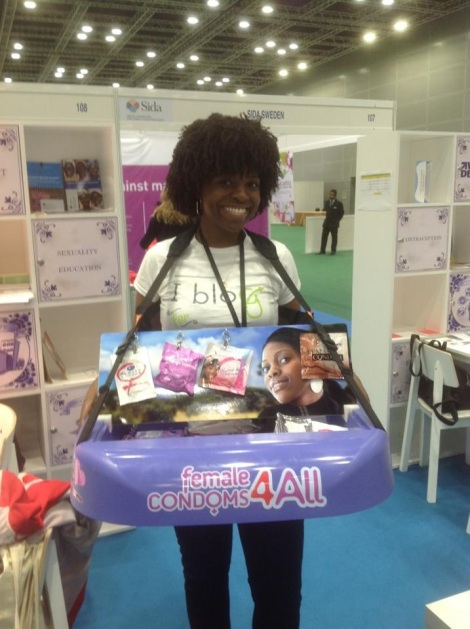 Blogger Camaro West at the Universal Access to Female Condoms' booth at the Women Deliver Conference