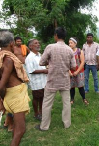 Talking with Gram Vikas village chief about WASH1