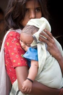 A sister holds her baby brother in Uttar Pradesh, India.  Photo Credit: Gates Foundation on Flickr