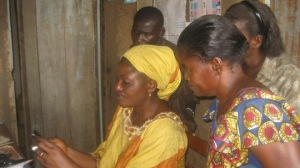 Bernadette Ntumba, Coordinator of AMCAV, provides training for camera operation