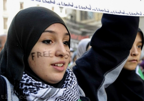 """Image courtesy of Freedom House/Flickr. A young woman with the words """"Free Syria"""" written on her face attends a demonstration against violence in Syria on February 26, 2012 in Madrid"""
