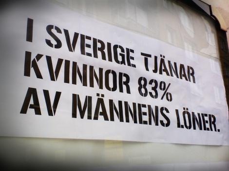 """In Sweden, women earn 87% of men's salaries."" Close up of poster. Photo Credit: Reclaim Reklam on Flickr"