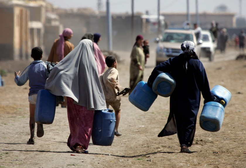 Egyptian's holding plastic barrels on his way to take water from pollution Canal at the Nile Delta town of Borg Al-Araib, 300 kms north of Cairo in March 16, 2008, during the 'UN World Water Day on 22 March'