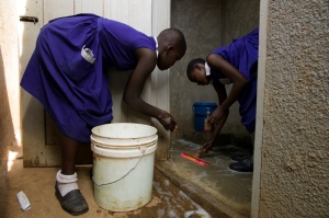 Female students at Kasasa School in Uganda cleaning their new latrines. Photo c/o Lynn Johnson, Ripple Effect Images