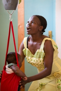 Mother weighing her baby at a clinic outside of Meru, Kenya