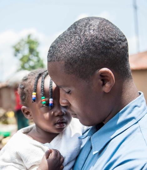 Father caring for his daughter in Rwanda.  Photo Credit: Perttu Saralampi / Promundo