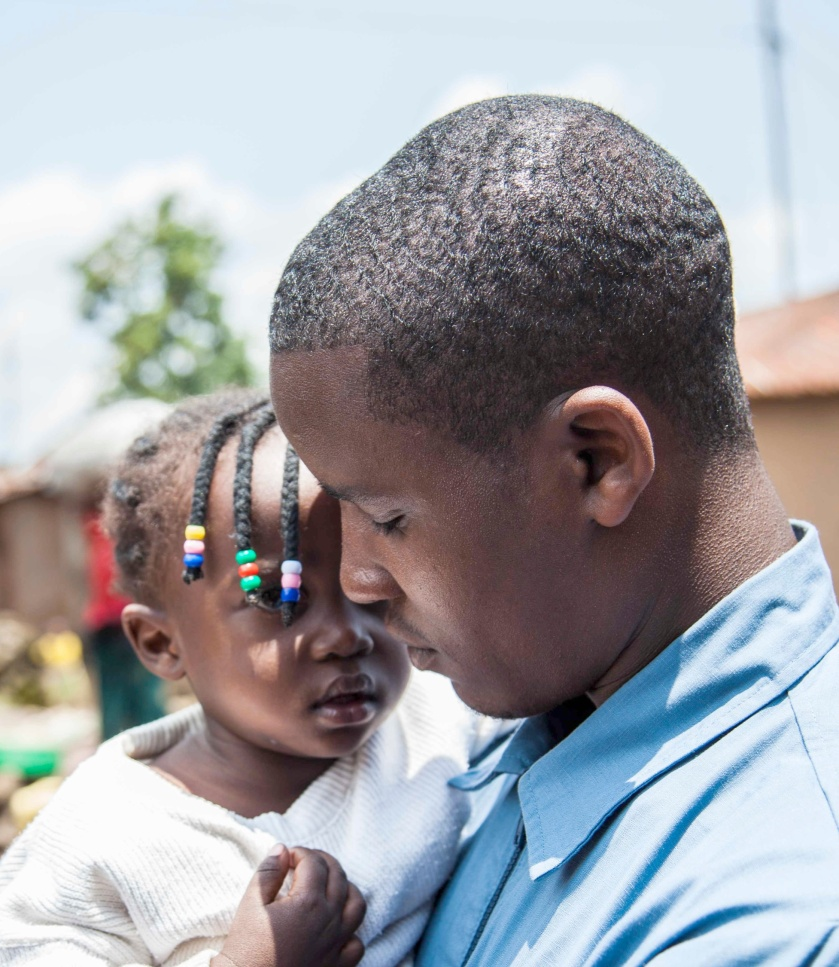 Father caring for his daughter in Rwanda.  Photo Credit: Perttu Saralampi / Promundo