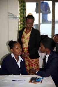 Resonate's Lead Trainer, Solange Impanoyimana, coaching Neda and a fellow student Photo Credit: Resonate