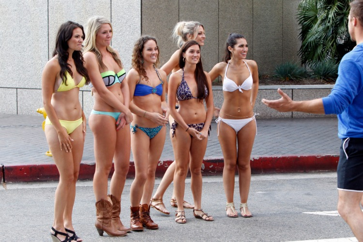 The Bachelor contestants get ready to ride tractors in the bikinis in downtown Los Angeles. Image c/o ABC.