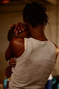 Now I am free. A female sex worker and child. Photo Credit: Laurenz Paas for Theatre for a Change