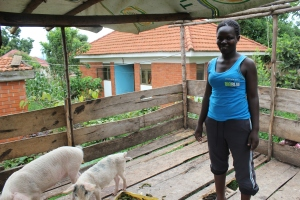 Martha aged 24, who runs a business rearing pigs and receives support through GUIU. Photo credit: Kimberly Wolf
