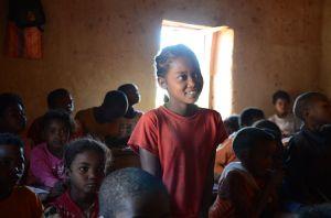 Ze back in her classroom at school; WaterAid/ Ernest Randriarimalala