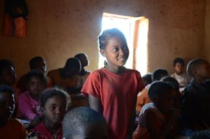 Ze back in her classroom at school; WaterAid/ Ernest Randriarimalala