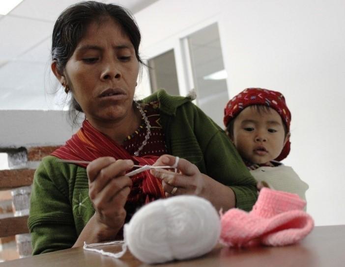 Woman in Guatemala making baby booties (1)