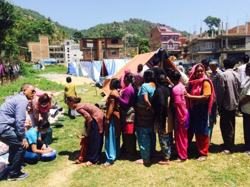 Relief supply distribution with tents in background
