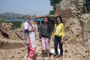 Sonu Tamang and in the background her house Photo Credit: Little Sisters Fund