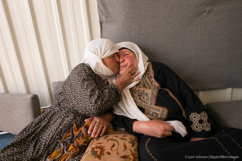 """After a year in this refugee camp, this grandma will return to Syria. """"I want to go home,"""" she says. """"But I feel like I'm setting my heart on fire by leaving my family behind."""" She said that her soul will be alive again when she kisses the earth of her homeland.   Photo by Lynn Johnson."""