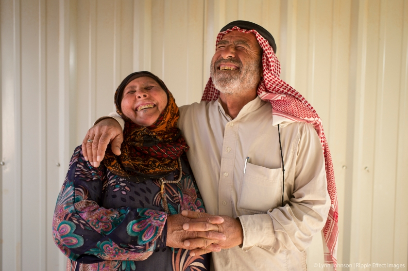 A Syrian husband and wife share a laugh while telling stories about drinking tea and listening to the radio morning to get through difficult times. They bring one another joy and, together, are keeping their family connected with a thread of hope.  Photo by Lynn Johnson.