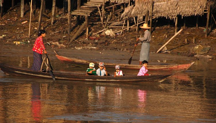 Transport by boat to school. Photo Credit: Melody Mociulski