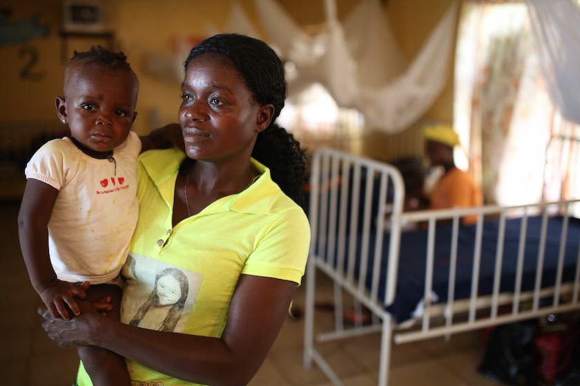 A portrait of Massa Foley and her daughter, Kona Taylor at the Liberia Government Hospital in Tubmanburg, Liberia  on June 24, 2015. Photo © Dominic Chavez/World Bank