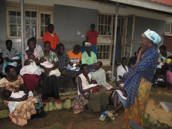 Philo talks to women at a rural health facility in Lira