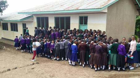 Tanzanian girls receiving menstrual pads through The Purple Box. Image used with permission.