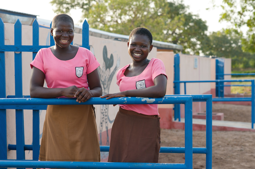 Amina Kombat (left) and Rahama Ishawa in front of latrines built by WaterAid with funding from HSBC Malta on 10 November 2015 at a senior high school in the Northern Region of Ghana.